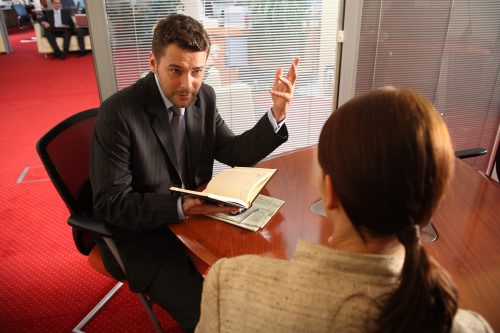 Business owner in meeting room having conversation with business coach melbourne